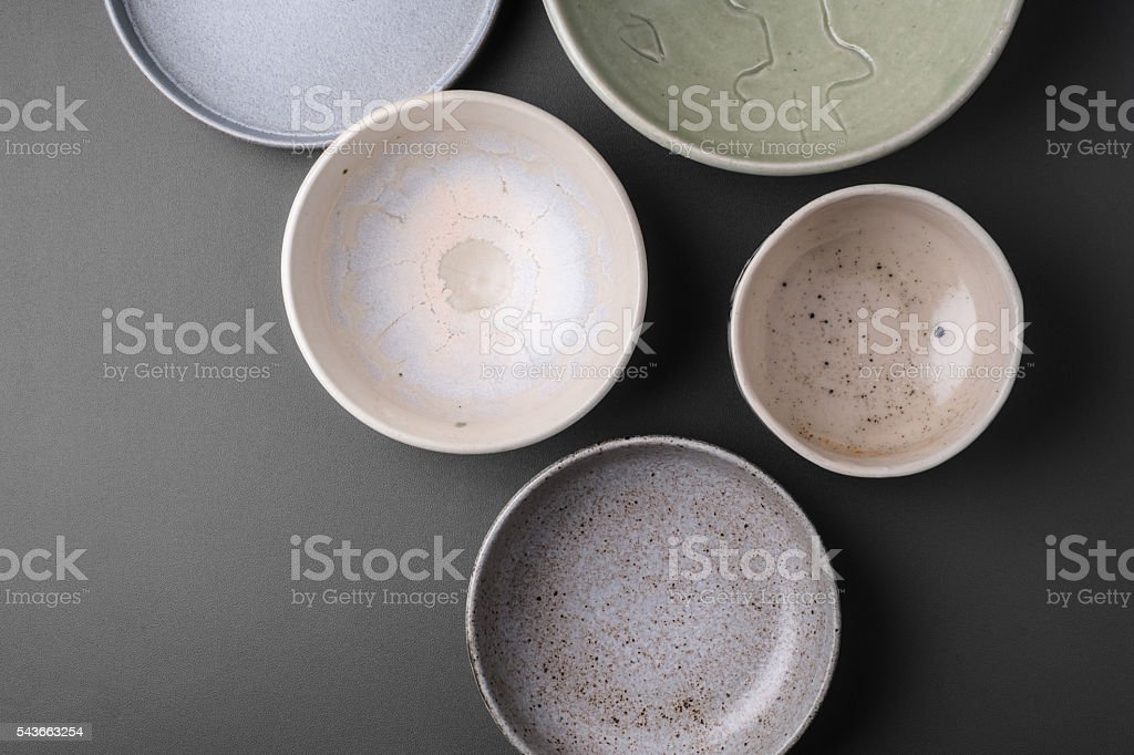 ceramic bowls on grey background stock photo