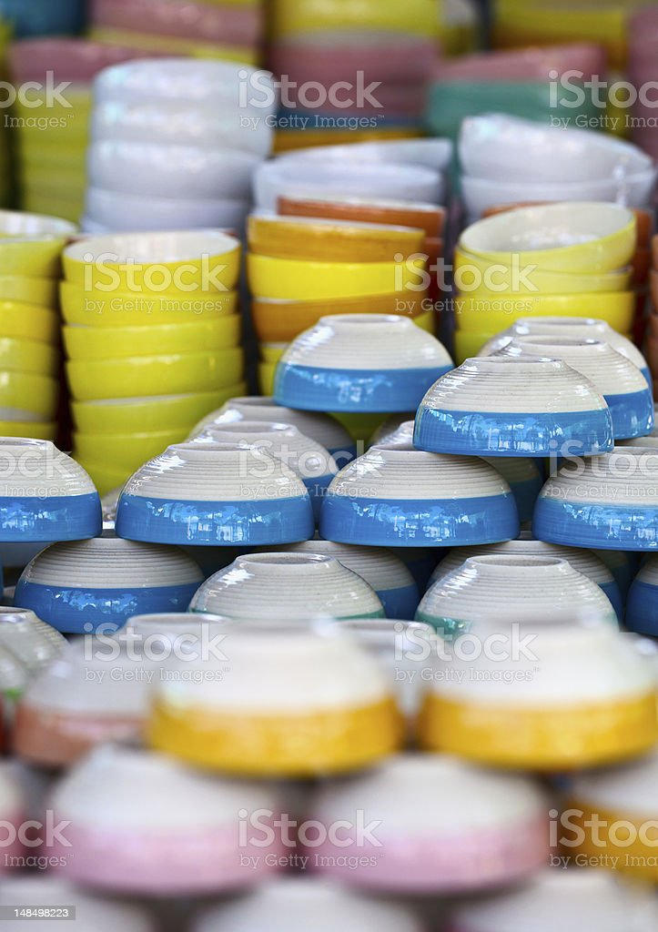 Ceramic color dishes on market royalty-free stock photo
