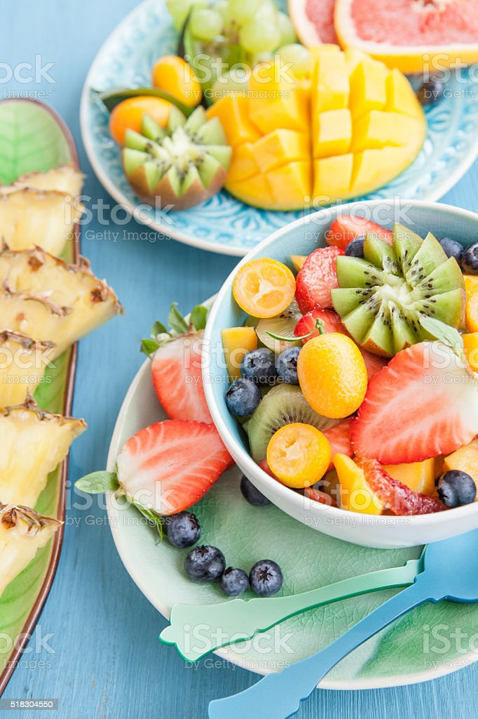 Ceramic cup with fresh fruit salad stock photo