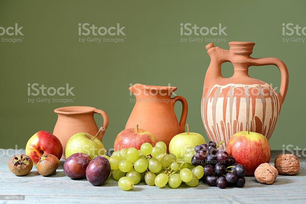 Ceramic dishes and fresh fruit stock photo