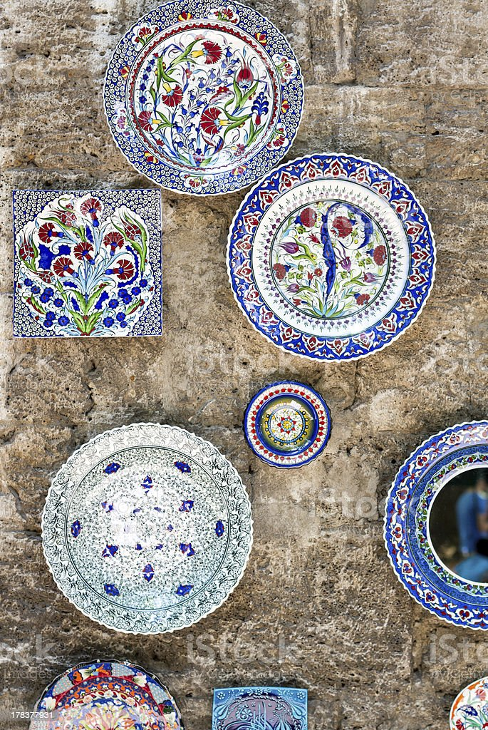 Ceramic dishes on the wall stock photo