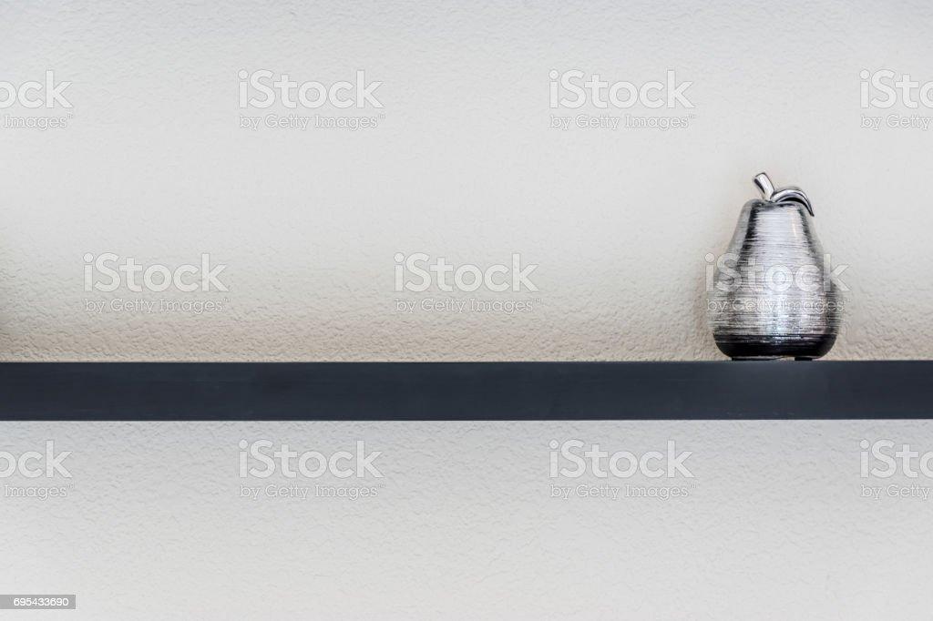Ceramic fruit on wooden shelf stock photo