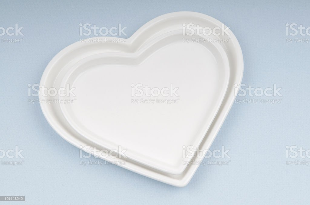 Ceramic hearts with a blue background royalty-free stock photo