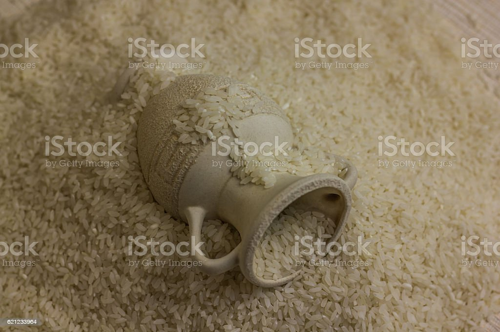 ceramic jar on a scattered rice stock photo