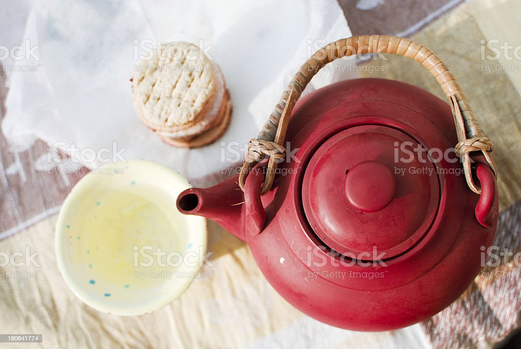 ceramic kettle and cup of green tea royalty-free stock photo