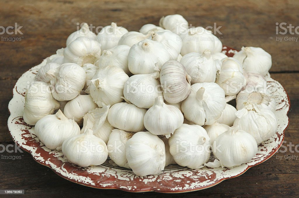 Ceramic plate with garlic royalty-free stock photo