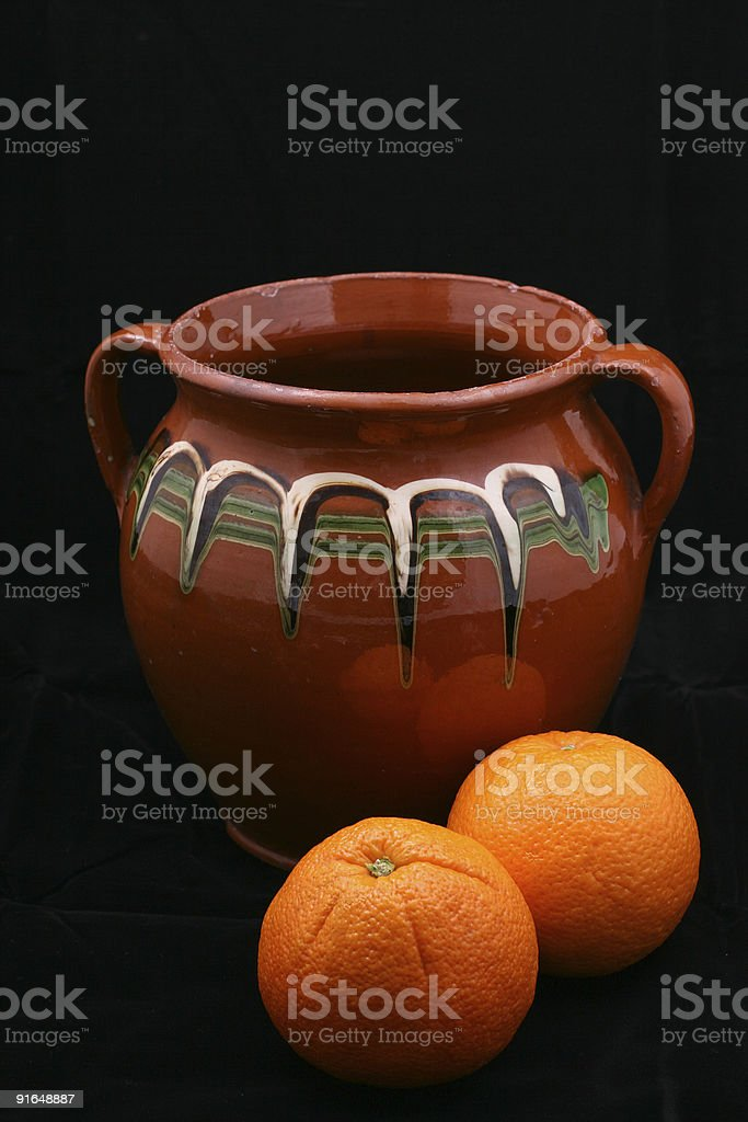 ceramic pot and oranges royalty-free stock photo