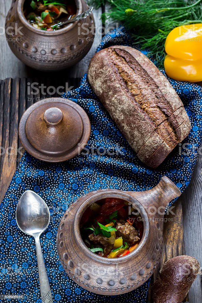 Ceramic pot with meat and vegetables. stock photo