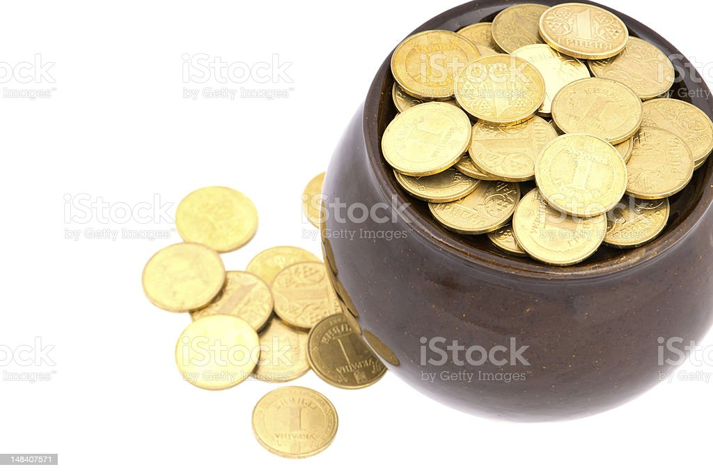 Ceramic pot with metal money royalty-free stock photo