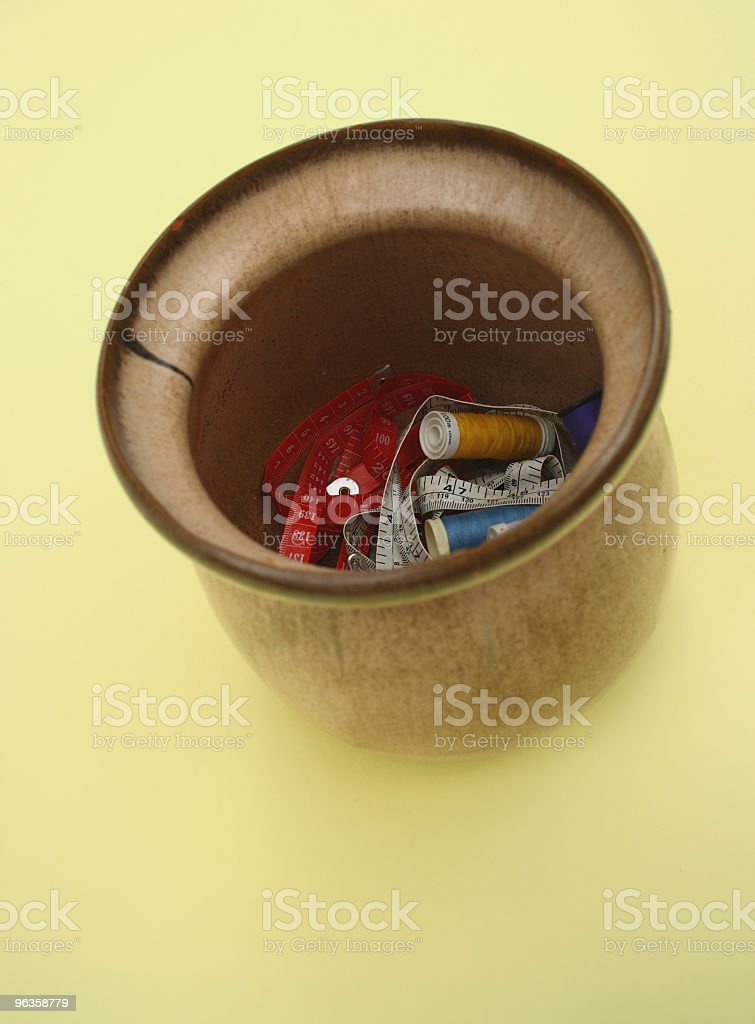 ceramic pot with sewing supplies stock photo