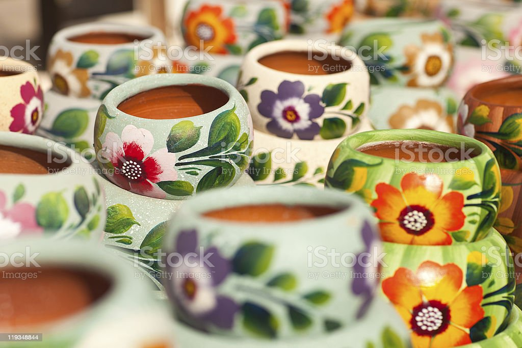 Ceramic pots with flower designs painted on them  stock photo