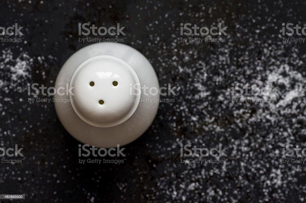 Ceramic salt shaker on black background stock photo