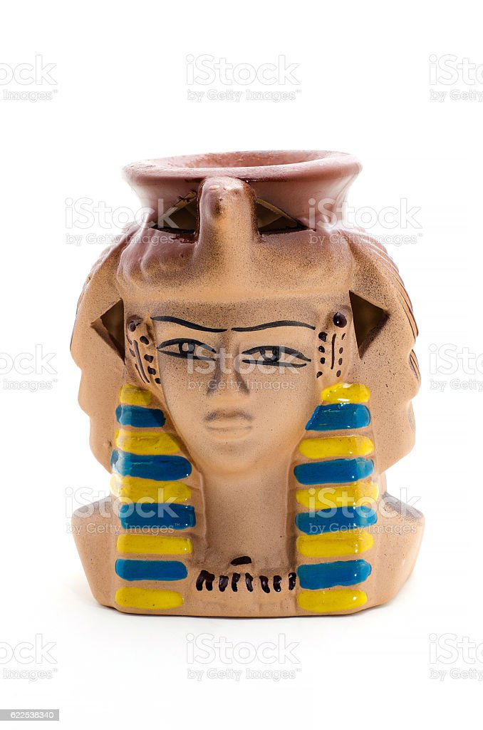 Ceramic statuette of pharaoh Candle Holder on a white. stock photo