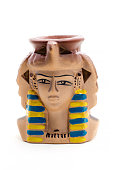 Ceramic statuette of pharaoh Candle Holder on a white.