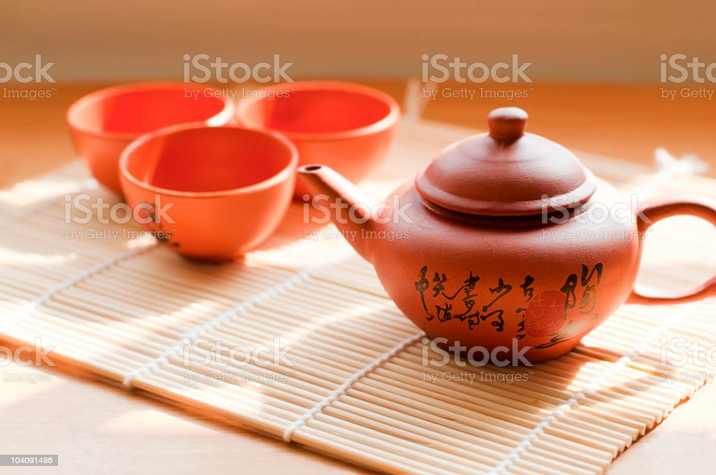 Ceramic teapot and teacups with Chinese inscription stock photo