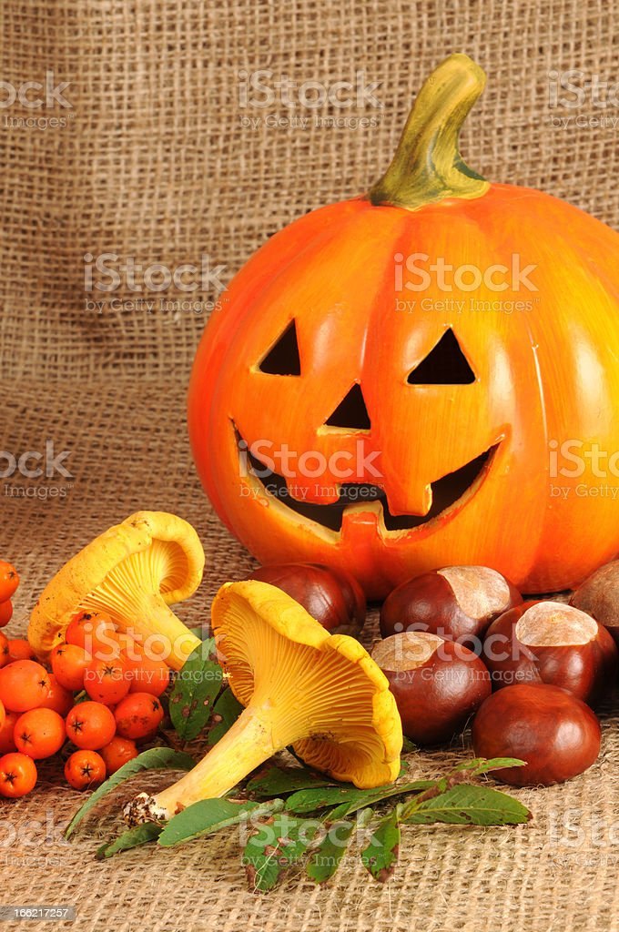 ceramics halloween pumpkin with chestnuts and mushroom royalty-free stock photo
