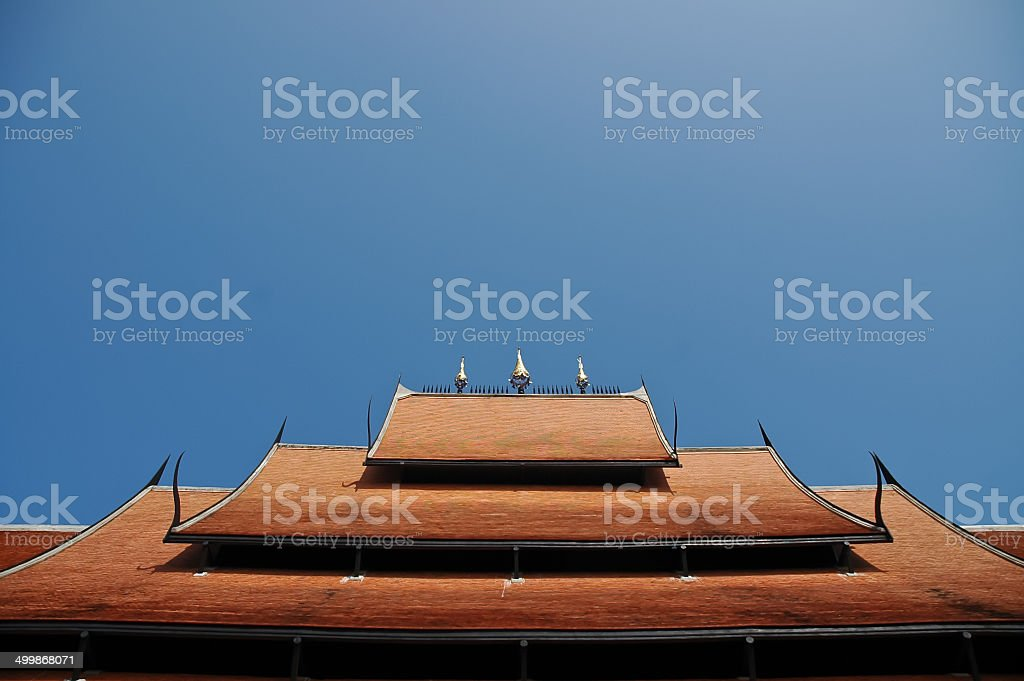 Ceramics roof of Thai temple under blue sky royalty-free stock photo