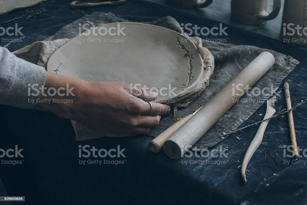 Ceramist working with clay in a ceramics workshop stock photo