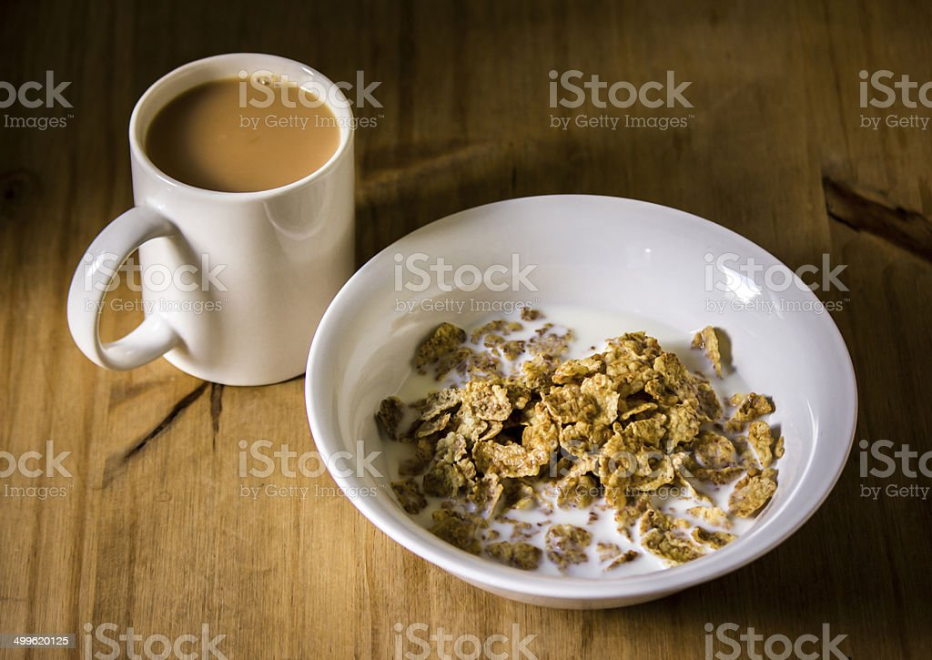 Cereal and tea for breakfast stock photo