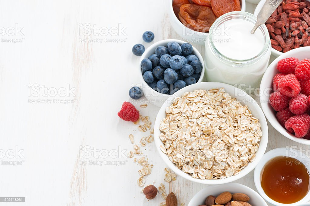 cereal and various delicious ingredients for breakfast stock photo