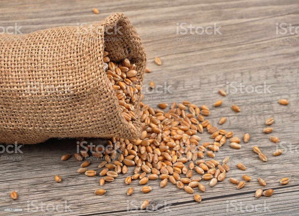 Cereal bag on wood stock photo