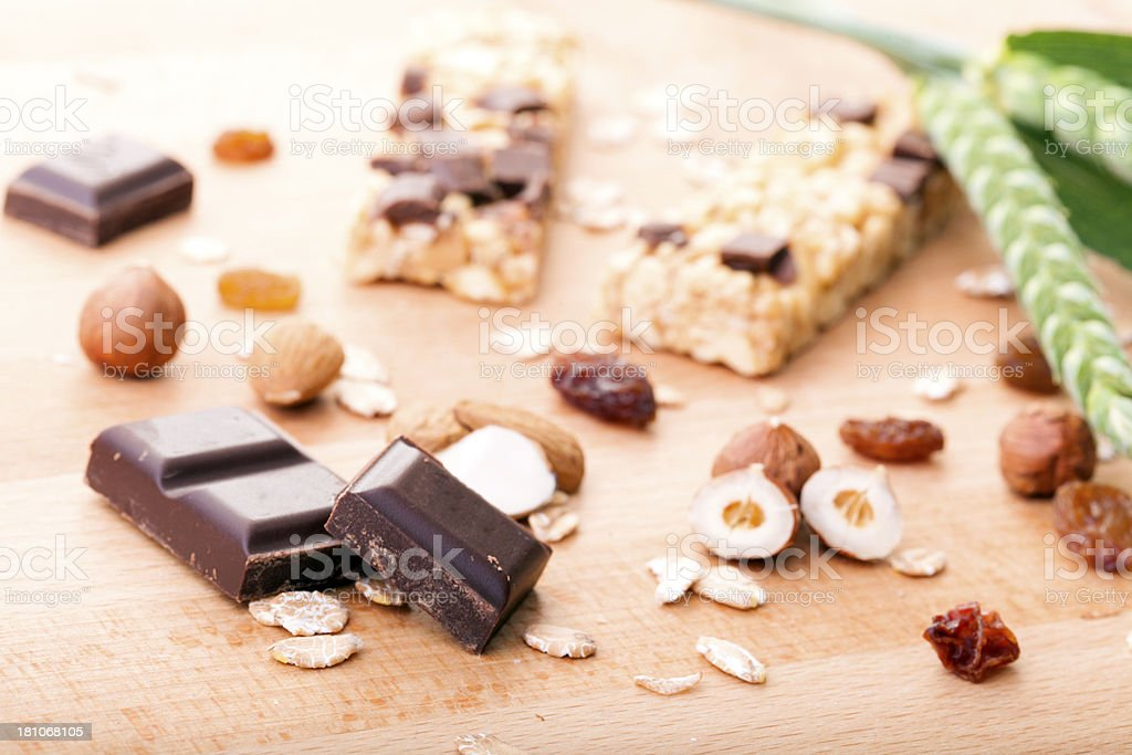 Cereal bar with chocolate,  almonds, nuts and raisins royalty-free stock photo