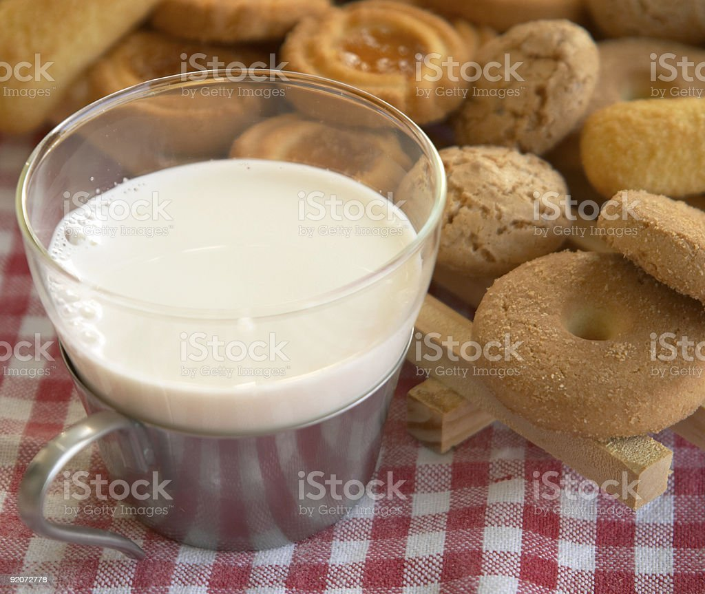Cereal biscuits and a cup of milk: Italian style breakfast royalty-free stock photo