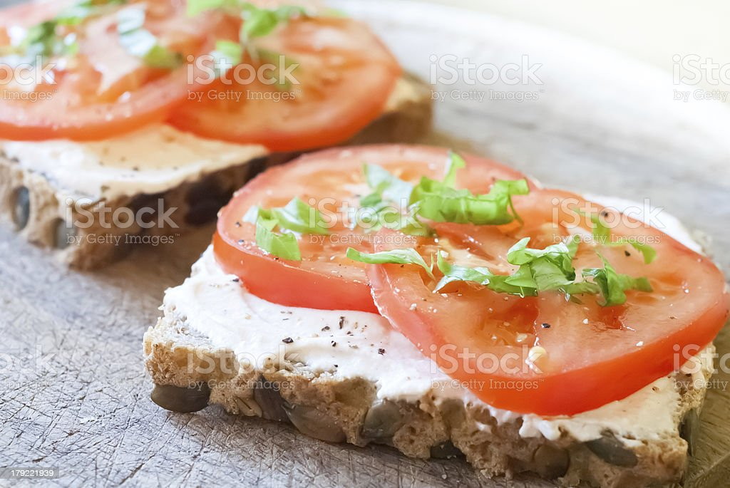 Cereal bread slice with tomato and ricotta royalty-free stock photo
