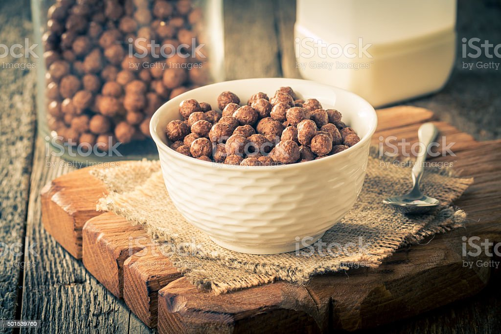 Cereal chocolate balls in bowl stock photo