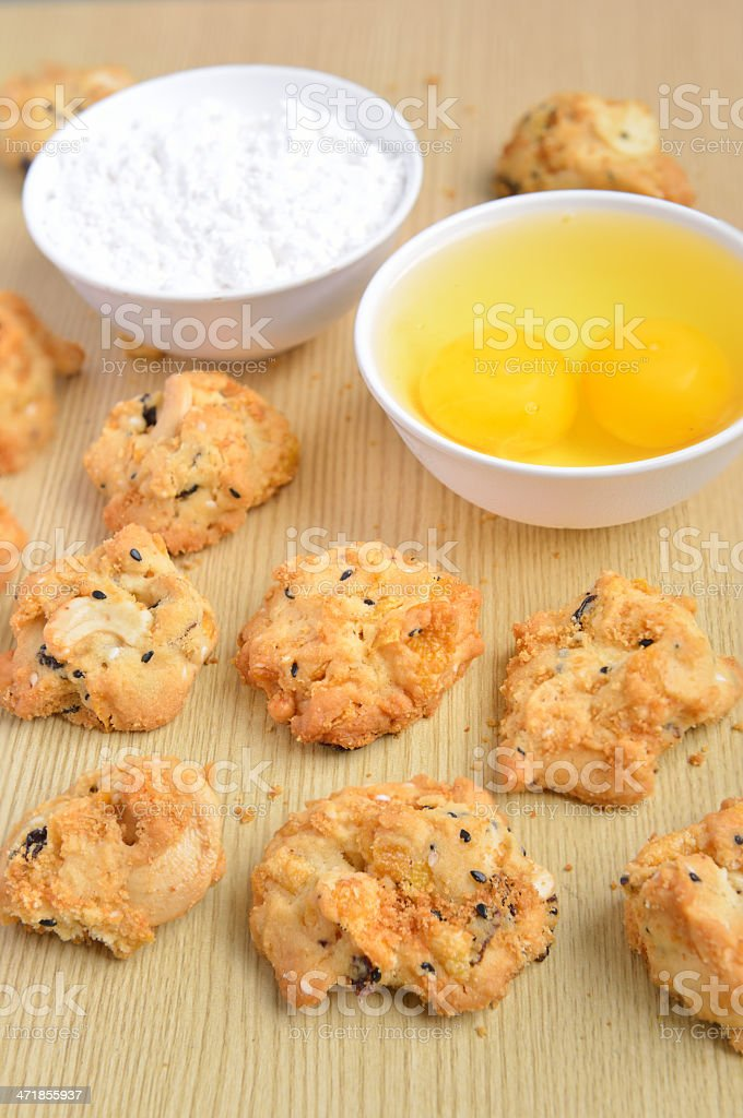 Cereal cookies on a wooden panel with ingredients royalty-free stock photo