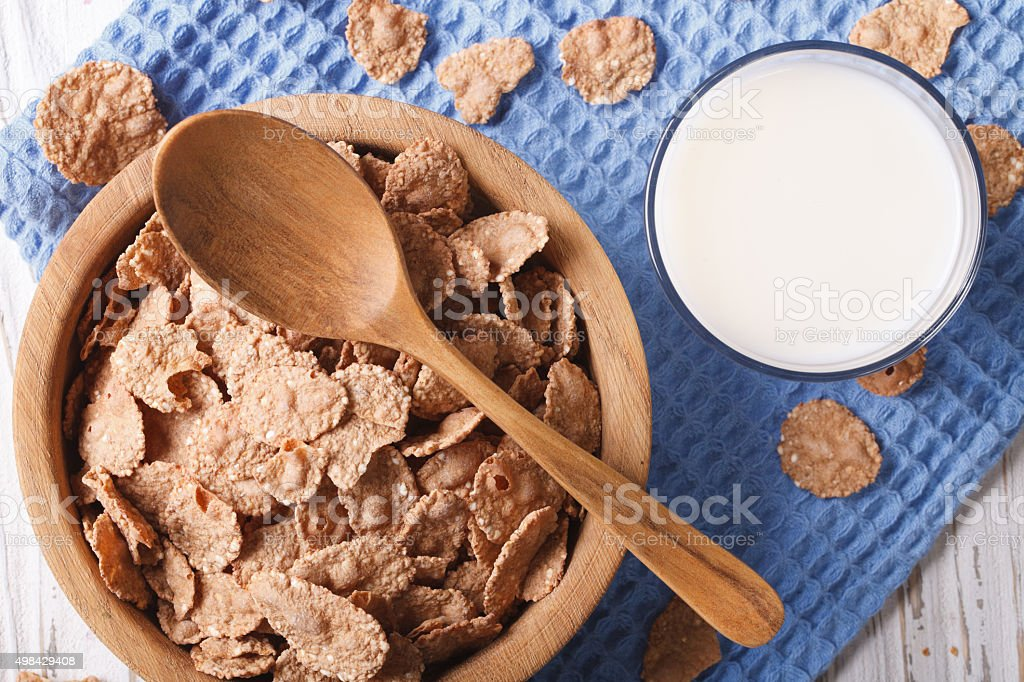 Cereal flakes in bowl and milk close-up. top view horizontal stock photo