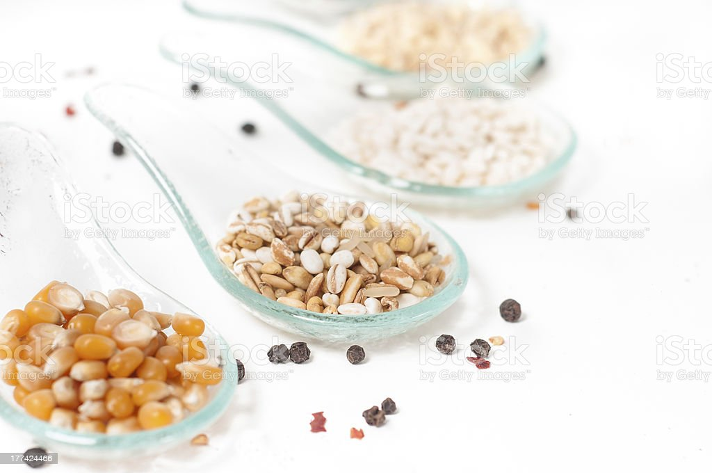 Cereals _ grains on glass spoon stock photo