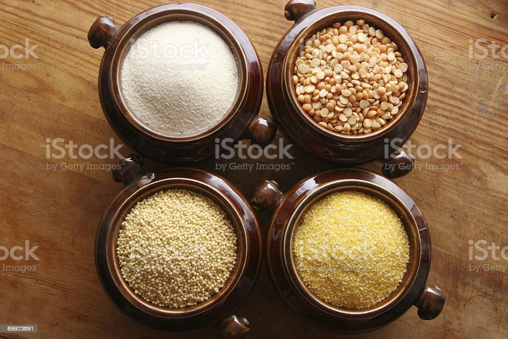 Cereals in ceramic pots. royalty-free stock photo