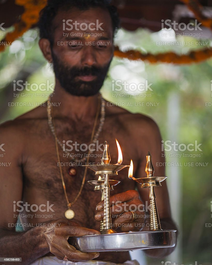 Ceremonial flame, Hindu priest, Kannur, Kerala, India. royalty-free stock photo