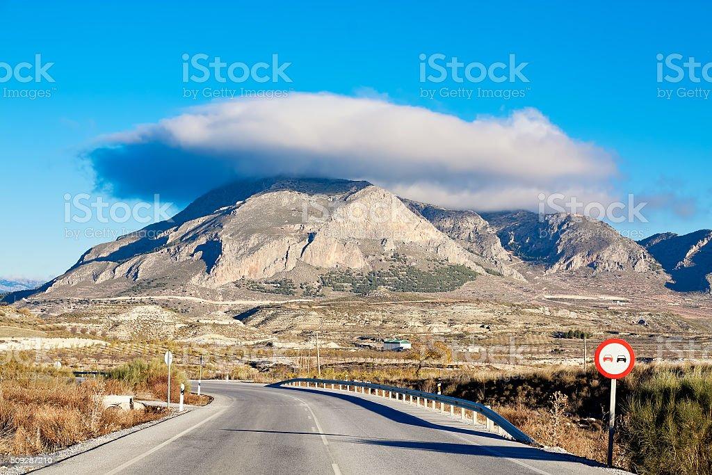 Cerro Jabalcon mount and Lenticular cloud near Baza. Spain stock photo