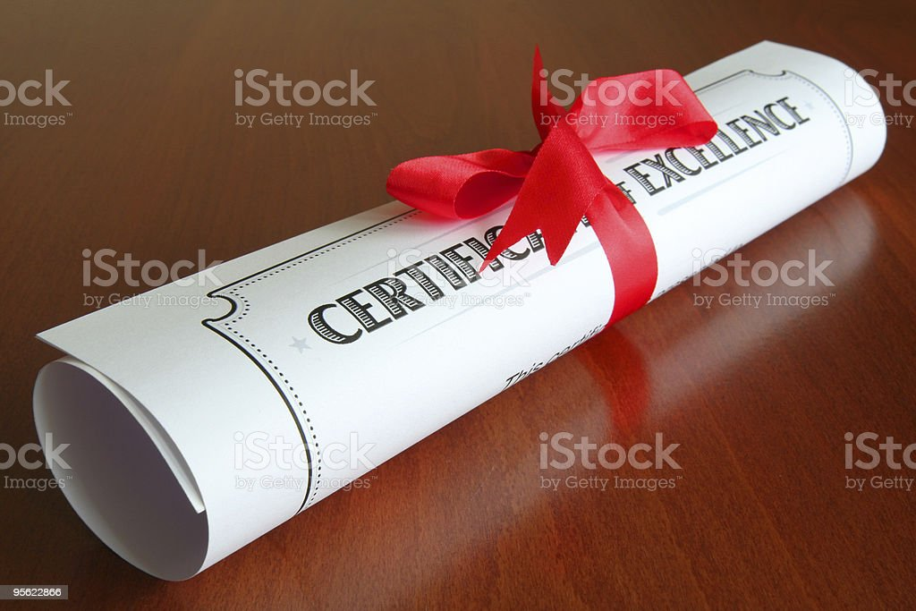 A certificate of excellence with a red ribbon royalty-free stock photo