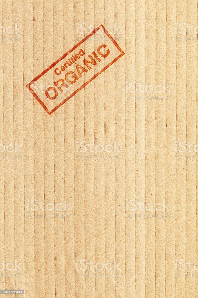 Certified Organic Rubber Stamp Impression on Brown Carboard Vt stock photo