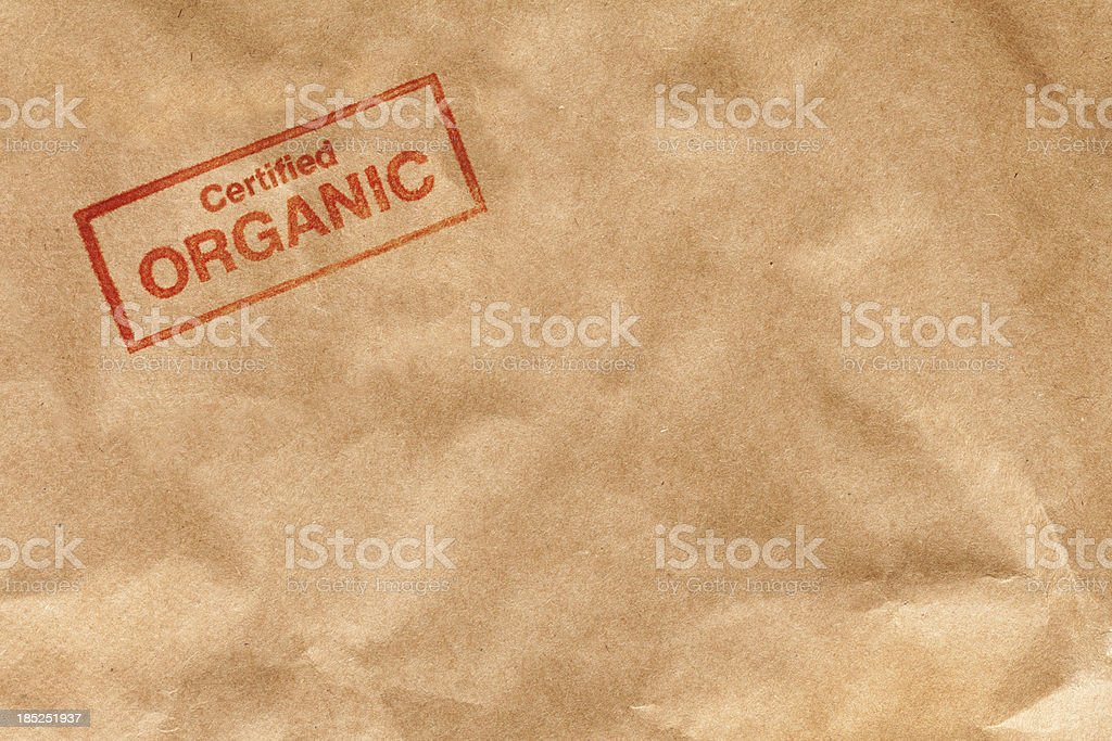 Certified Organic Rubber Stamp Impression on Brown Kraft Paper Hz stock photo