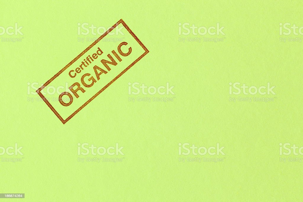 Certified Organic Rubber Stamp Impression on Green Background Hz stock photo