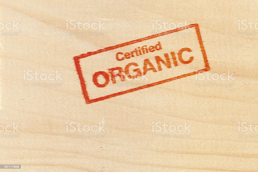 Certified Organic Rubber Stamp Impression on Wood Background Vt stock photo