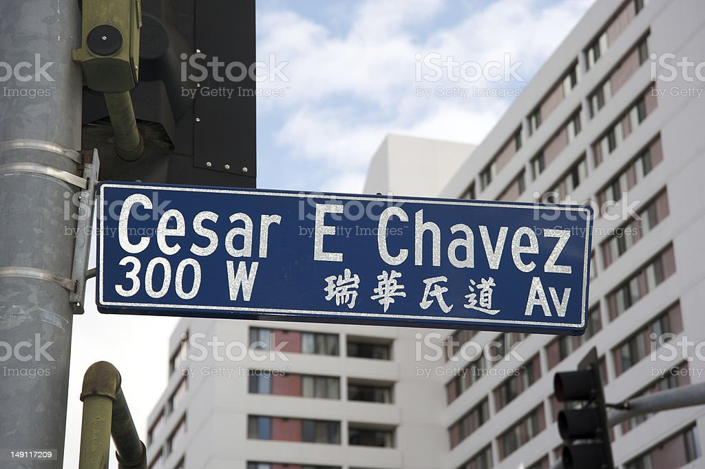 Cesar E Chavez Ave street sign in English and Chinese royalty-free stock photo