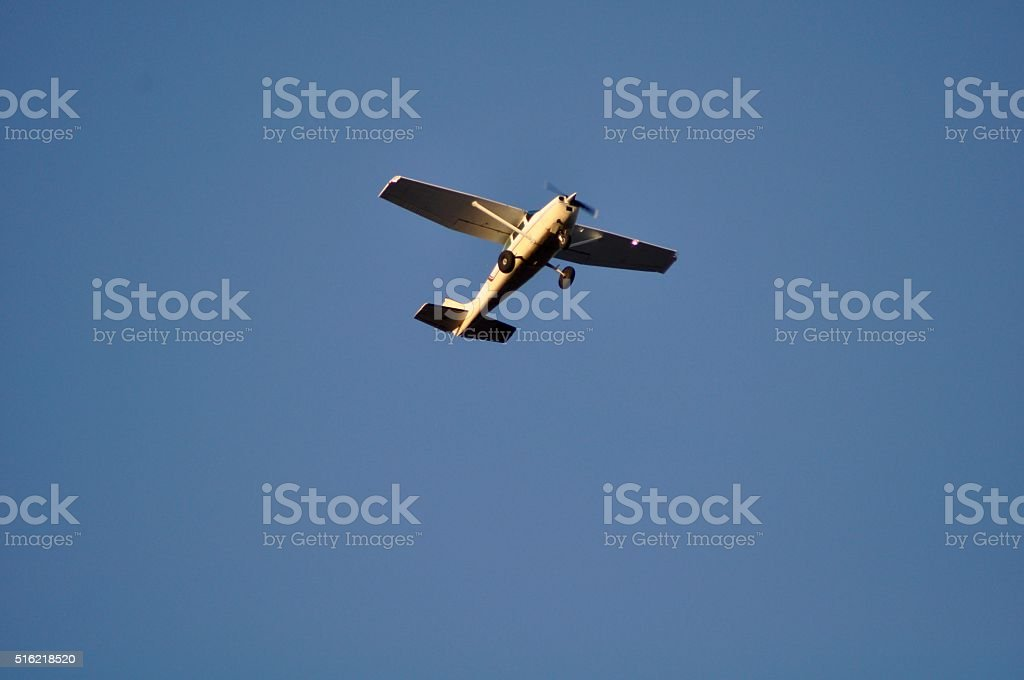 Cessna Airplane Flying Overhead in Bluesky stock photo