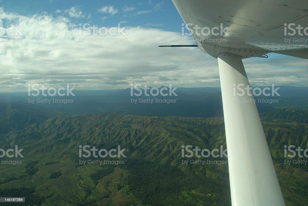 Cessna Airplane over Rainforest stock photo