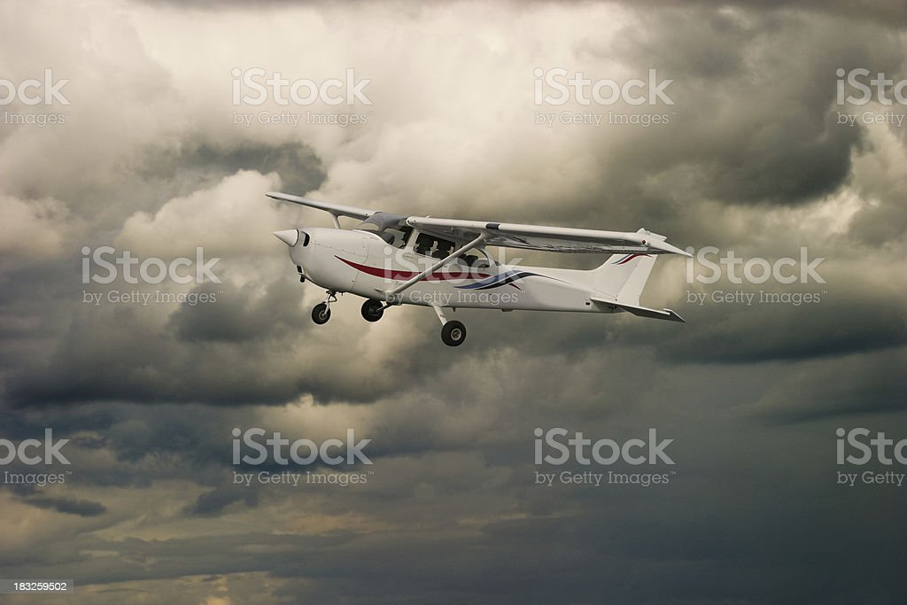 Cessna in the Sky (warm colors) royalty-free stock photo