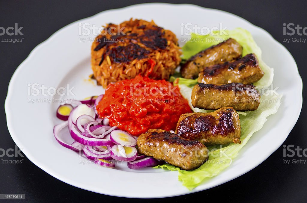 Cevapi with rice, ajwar and onion stock photo