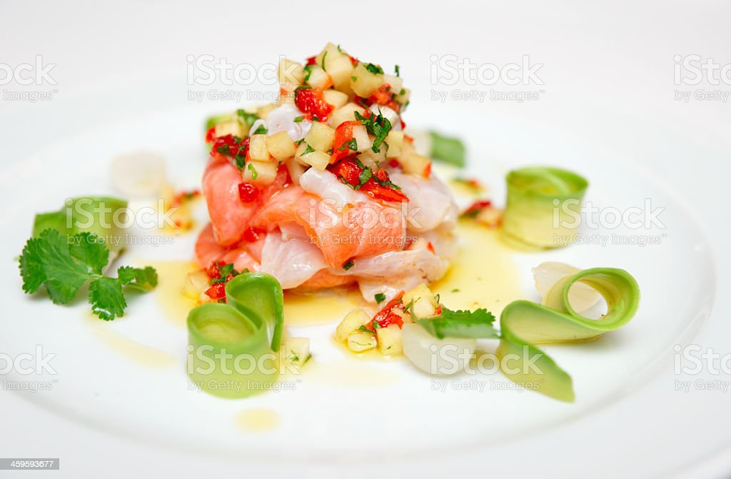 Ceviche Seanad and salmon on a white plate with garnish stock photo