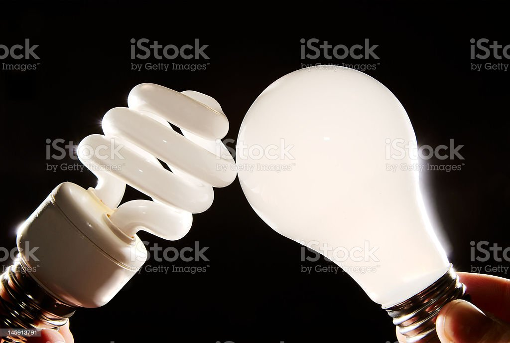 Cfl fluorescent and incandescent light-bulbs stock photo