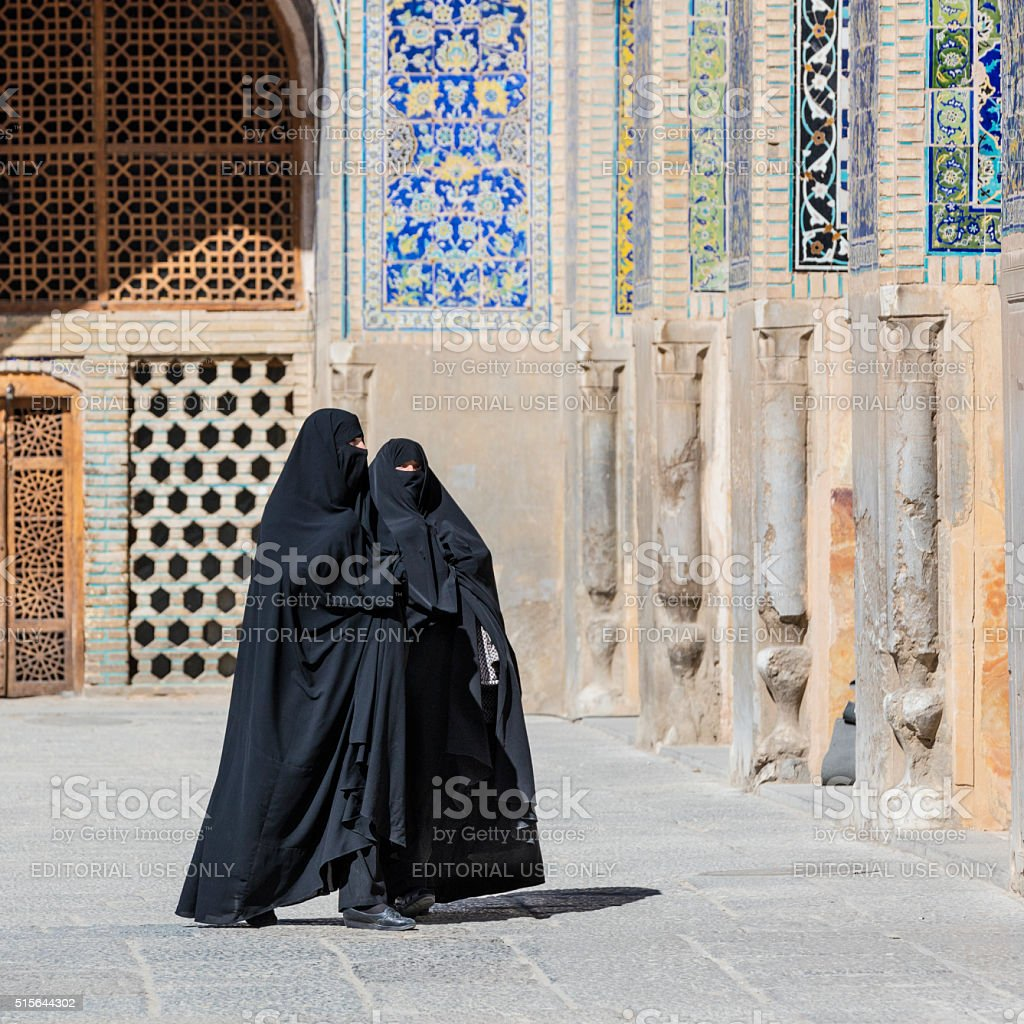 Chador-clad Women at the Masjed-e Imam, Isfahan, Iran stock photo