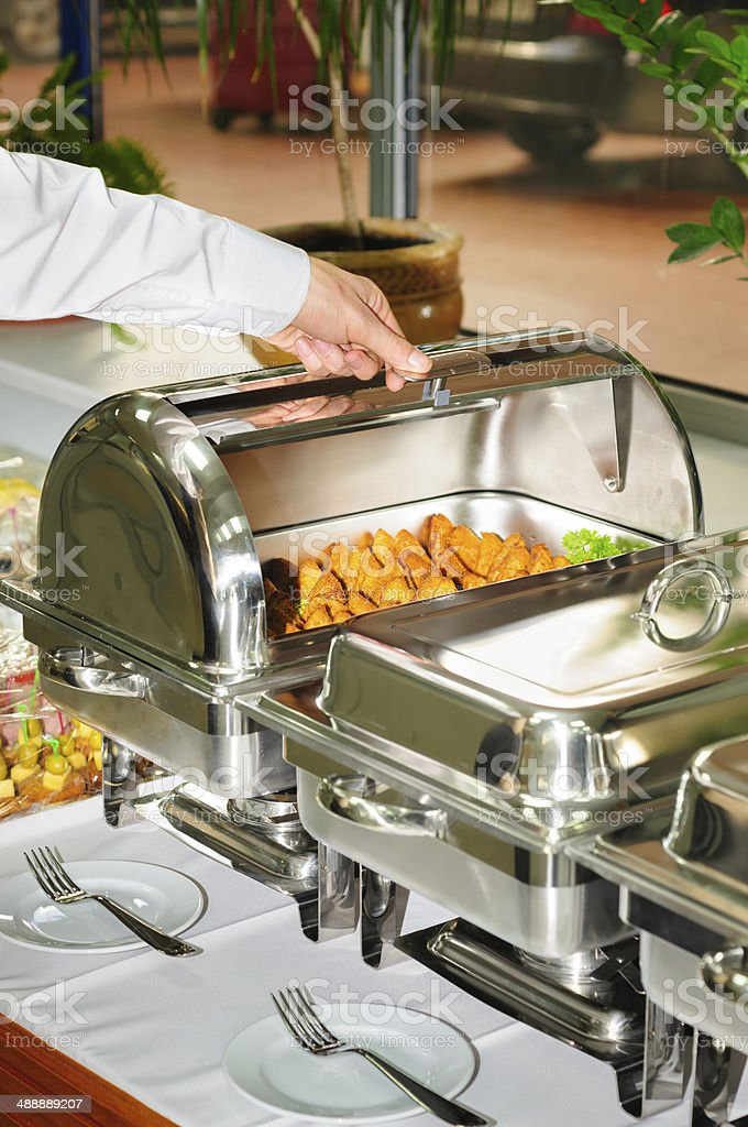 chafing dish heater with grilled meat stock photo