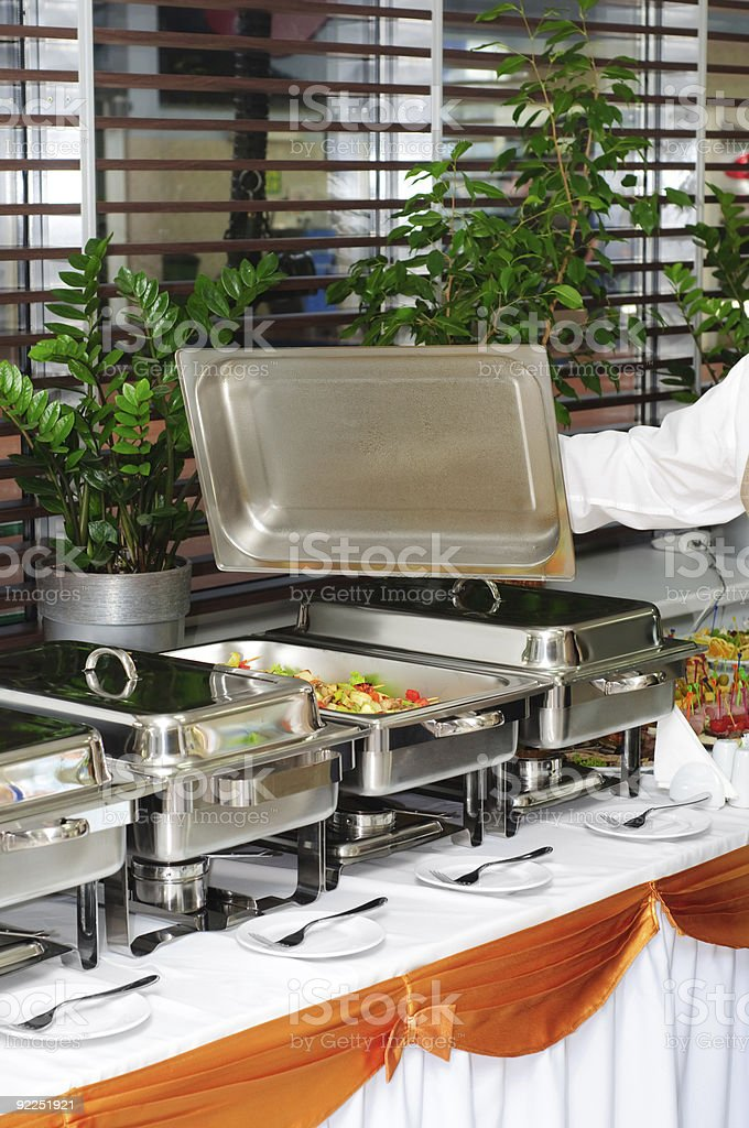 chafing dish heater with vegs kebab stock photo